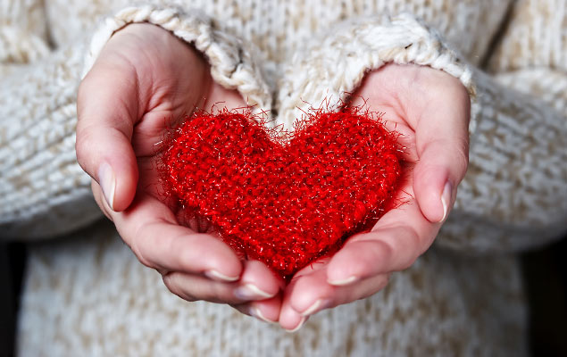 BLG Cares - Hands holding a knitted heart