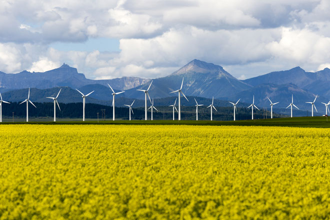 Alberta Power Market - Wind turbines in front of mountains